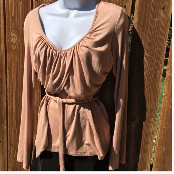 Gorgeous Daisy Fuentes Peach Draping Top Gorgeous Daisy Fuentes Peach Draping Top.  Size Medium.  Good pre-owned condition.  Long sleeves and attached belt.  Very flattering style. Color is peach. Daisy Fuentes Tops