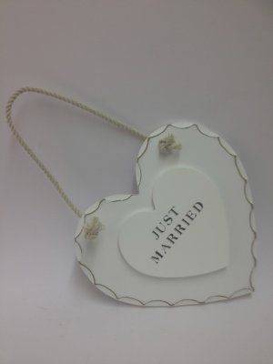 Just Married Wooden Plaque £5.99 Shabby chic wooden plaque with attached string to hang and smaller raised heart in the centre featuring the phrase 'Just Married'. Perfect as a gift fo the newleyweds or to decorate the venue. Approx Dimensions: H: 16cm x W: 17cm x D: 0.5cm