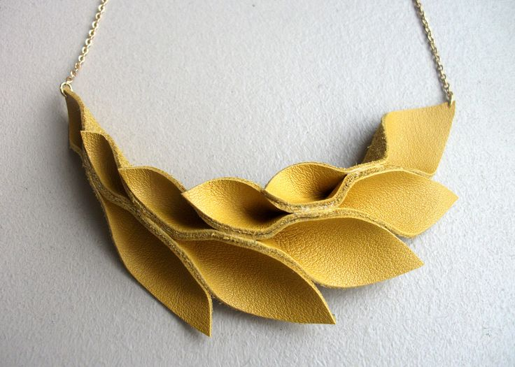 Made from Leather but they give me a great idea for some poly clay jewelry. Bright Yellow Leather Petal Necklace. $24.00, via Etsy.