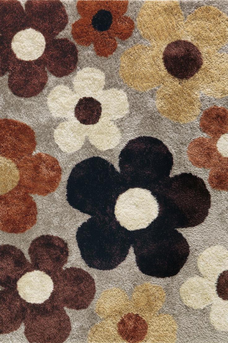 Retro en Vintage zijn woonstijlen die blijven, met mooie hergebruikte meubels en accessoires uit de fifties. Voor tienermeisjes die dol zijn op deze interieurstijl, is dit bloemenvloerkleed een perfecte match! Aaibaar zacht in warme 50-er jaren kleuren - een bijzonder ontwerp uit de Arte Espina Lounge Collectie.