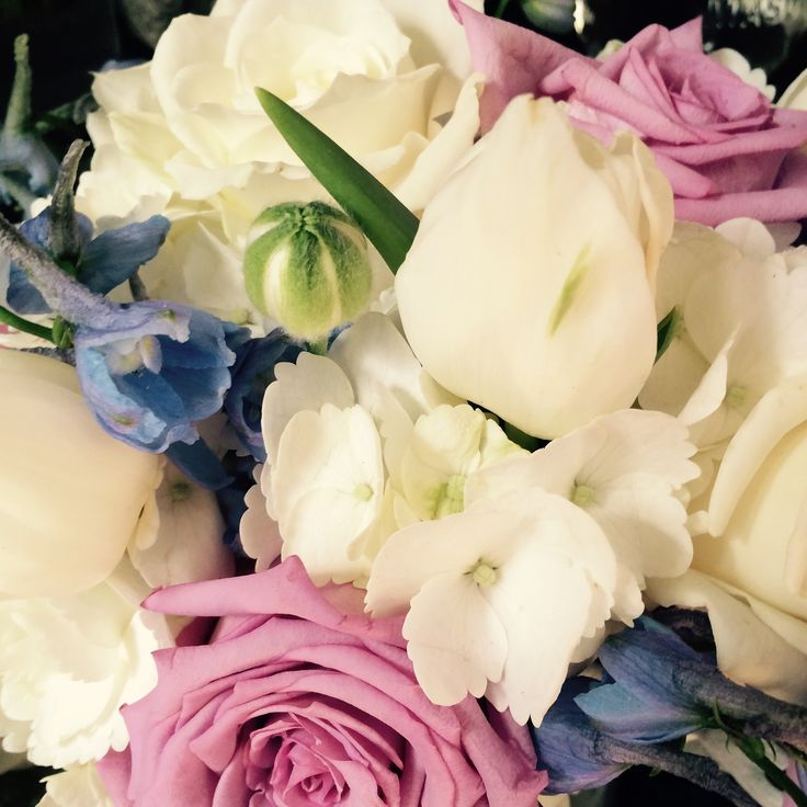 Avant Garde lavender roses, light blue delphinium, white tulip, white roses, white hydrangea by In Full Bloom