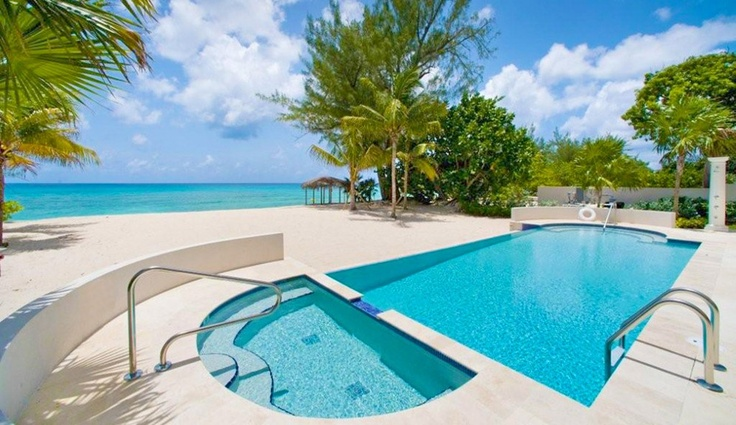 The beachfront pool at Inspirato's Calypso residence on Grand Cayman, Cayman Islands.