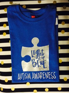Help LIGHT IT UP BLUE for Autism Awareness! 20% of the proceeds will be sent to Autism Speaks!!  Royal blue cotton shirt with silver puzzle piece and white lettering. Shirts are standard t-shirt cut and run true to size.