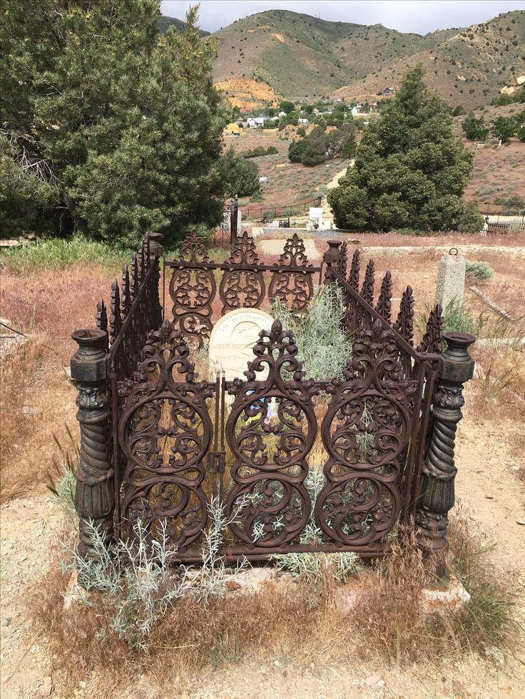 grave with decorative enclosure