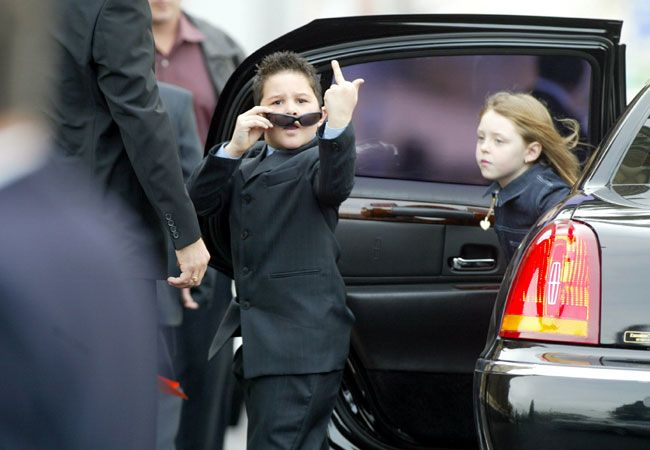 A young mourner (the son of Jason Moran) gestures at the media when arriving at the funeral of Jason Moran at St Mary's church in West Melbourne.  Photo:: Paul Harri...