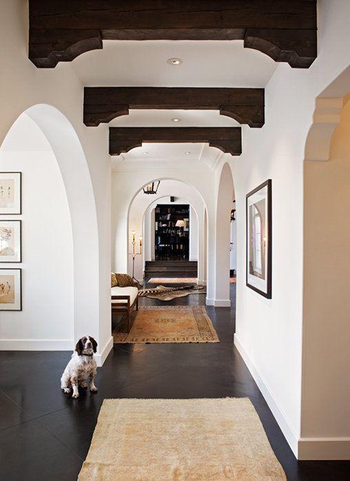 Dark Concrete floors, Light walls, Wood beams