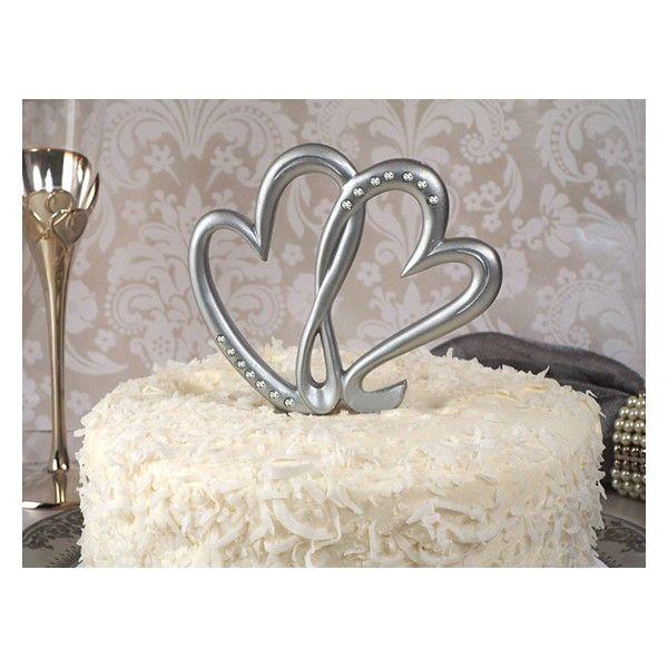 """Questo particolarissimo Cake Topper a tema estivo raffigura uno sposo che tiene  in braccio la sua sposa sulla riva di una meravigliosa spiaggia: il prodotto è realizzato  interamente in resina e la base è decorata con particolari come le conchiglie, il  mare azzurro ed increspato dietro gli sposi e la scritta """"Just Married""""  incisa sulla spiaggia a forma di cuore.   Misure: 17,8 x 12 x 9,5 cm."""