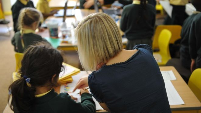"""A """"national crisis"""" in teacher numbers is looming, six unions representing teachers and school leaders in England and Wales have warned.  Government limits to teachers' pay and """"real terms cuts"""" to school budgets risk undermining standards, they warn.  """"Teachers need a pay rise,"""" they urge, in a joint statement to the School Teachers' Review Body (STRB), which sets their pay."""