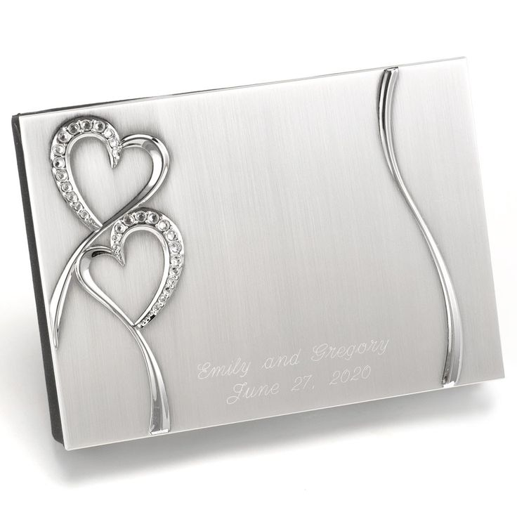 Brushed silver cover wedding ceremony guest book..rhinestone‑studded heart design and black velvet backing. Wedding day themes..traditional ues book design..Diamond Collection..add glam and sparkle to your wedding day.