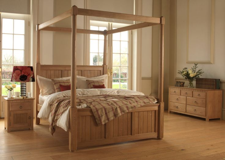Inspired by the fresh coastal look of New England, everything about this solid oak four poster bed works in harmony to create a blissful sanctuary of calm. This is a pared down, almost minimalist look, popular in soft hand-painted tones – or in solid oak with a hand-applied wax finish which brings out the effortless beauty of the tongue and groove wood panelling. #newenglandstyle #missionbed #shakerstylebed
