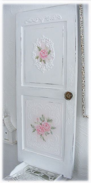 romantic shabby door-note to myself...using the french plaster technique like this door would be pretty on my bathroom cabinet door.