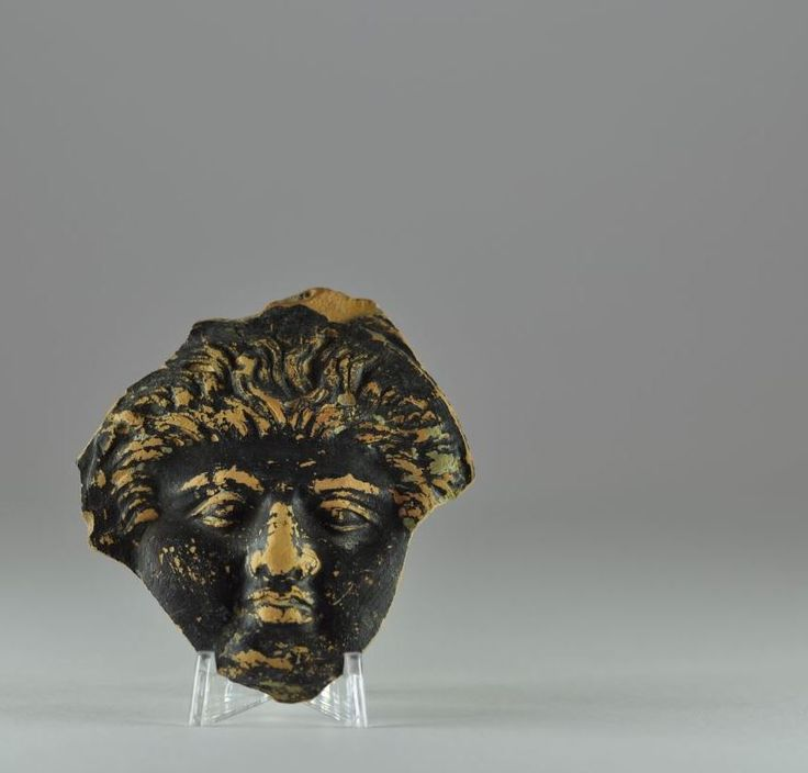 Greek terracotta head fragment, 4th century B.C. Greek terracotta head, Greek black ware pottery head of man with curly hairs, probably from a vase, 6.7 cm high. Private collection