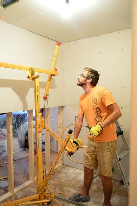 How to steer a tugboat. Just kidding, how to use this contraption to hang drywall