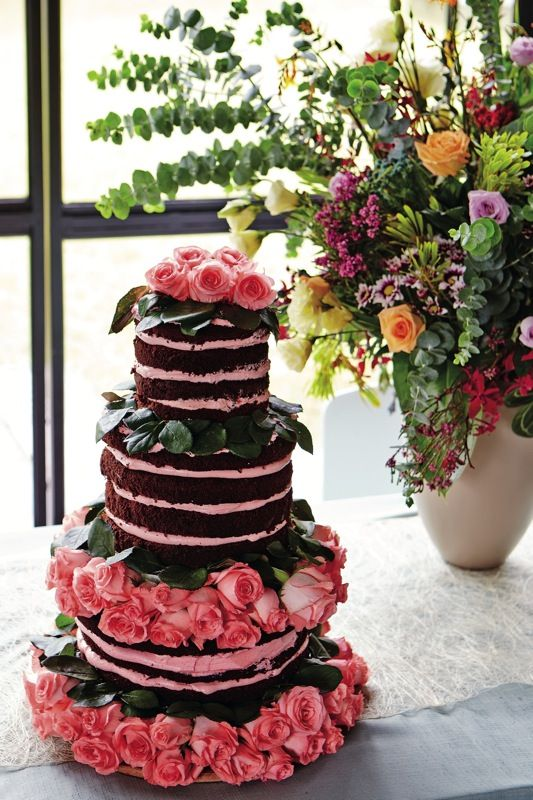 Partially dressed cakes are all the rage this season. They taste great and are generally cheaper than the fully iced. Our favourite recipe has a nearly-naked chocolate cake with creamy pink buttercream filling and fresh roses. Cake from Missus Bonbon. #cake #wedding #brides #hwbrides #sept2013 #ideaswelove #missusbonbon