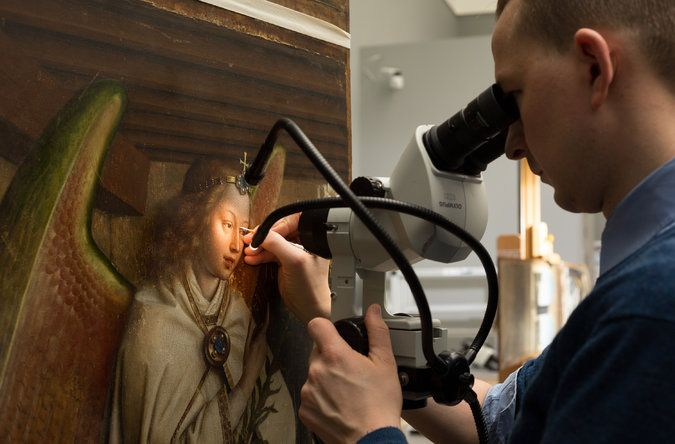 A scalpel was used to remove overpaint from an image of the Archangel Gabriel. Credit Jean-Luc Elias/KIK-IRPA, Brussels.  A Master Work, the Ghent Altarpiece, Reawakens Stroke by Stroke - The New York Times