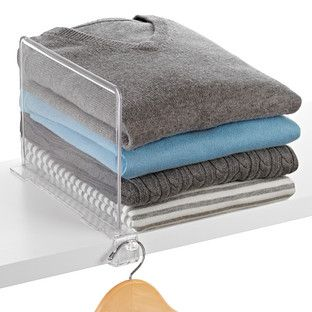 Our Clear Shelf Divider is the perfect solution to organizing sweaters, towels, handbags and more. A valet knob on the end creates extra hanging space. The clear construction and minimal design make for a seamless look in any closet!