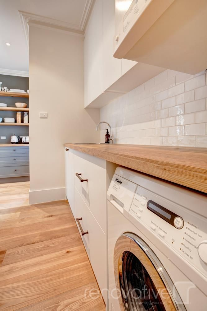 Laundry - Subway tile, timber top bench