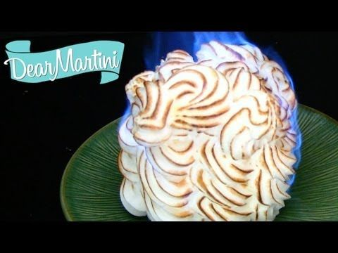 Baked Alaska - this website provides a great explanation of how to flambe the cake.
