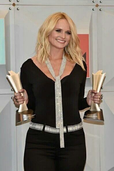 What is a CMA award, a AMC award, and a triple platinum certification?