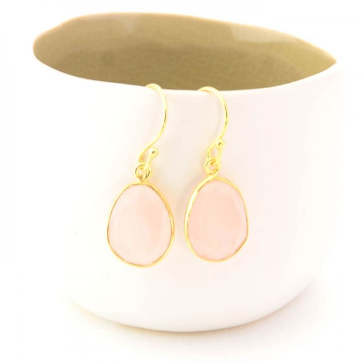 Cuff and Stone 925 silver earrings with gold hold a beautiful rose quartz gemstone.All stones are individually cut making them unique in colour and character. Each earring is hand made and set with all natural gemstones.