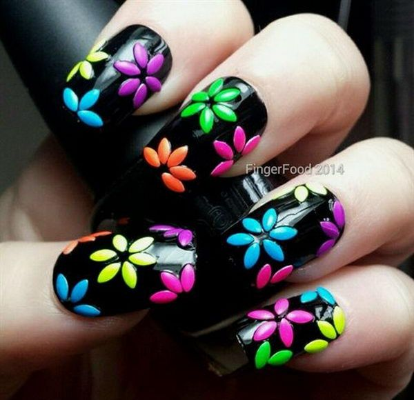 3D Nail Art with Colored Flowers on Black Background, 3D nail art is a technique…
