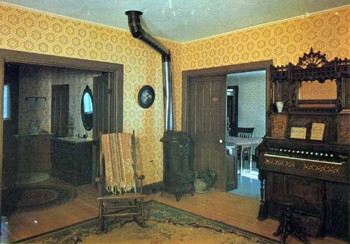 The Ingalls' living room in De Smet, South Dakota. Laura gave Pa her whole summer teaching salary ($75) to help buy this organ for Mary!