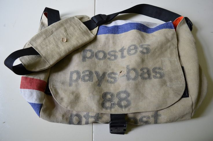 A large messengerbag made of a used postal service bag