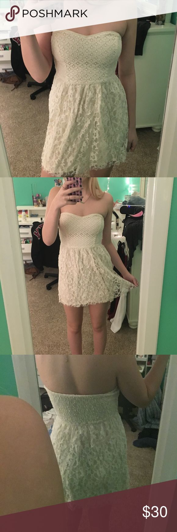 Cream hollister dress! Tight dress with a  floral design. Stretchy bust area so fits easily! Hollister Dresses Mini