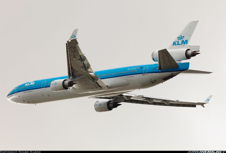 "KLM McDonnell Douglas MD-11 PH-KCD ""Florence Nightingale"" climbing away after departing Amsterdam-Schiphol, September 2011. (Photo: Szabo Gabor)"