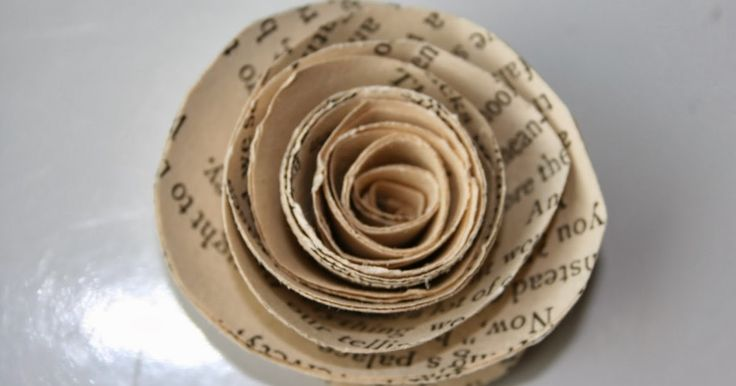 HOW TO MAKE PAPER PAGE ROSES           First you will need some old books. If you don't already have some you can find them at yard sales...