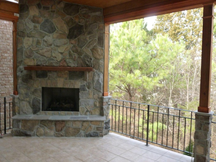Open porch in charlotte by archadeck with a tile floor for Fireplace on raised deck