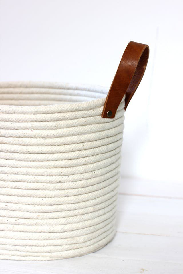 Round up of DIY Stylish Storage Bins | Don't limit yourself to clear plastic containers. Enter into the world of storage baskets. Make them with an easy, stylish DIY? Woven baskets make the perfect home for a stack of blankets in the living room, the pile of dirty laundry on the bedroom floor, toys, plants...you name it, and it can find a place in a storage basket. Keep the plastic containers for under the bed or in the closet, because you'll want to show these projects off.