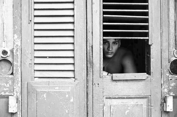 "Midnight Boy ""This boy is a male prostitute. His eyes nearly made me cry. He was so surprised I wanted to take a photo of him, while he sat like a sad, sulky dog looking out the window of his small, dark apartment, waiting for his next customer."" Isaebella Doherty talks about her series ""Postcards"""