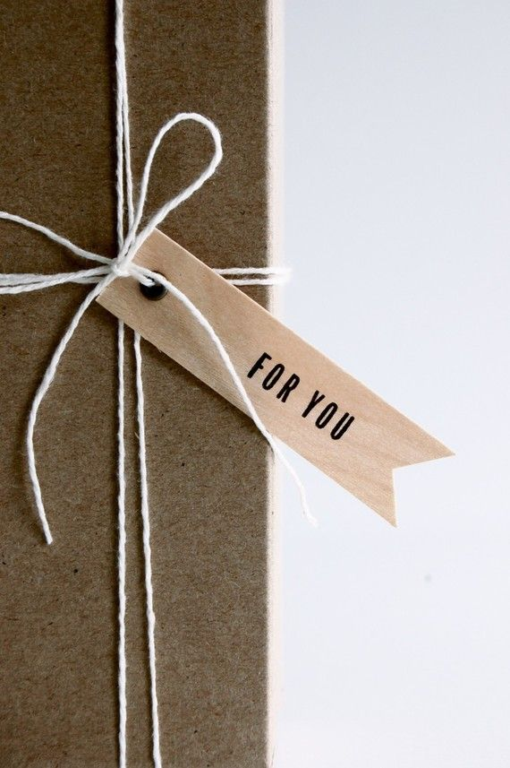 A plainly wrapped box with aletterpress gift flag. simple and elegant. #giftwrap #gifttag