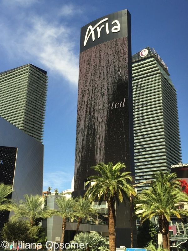 Aria Resort and Casino—The showpiece of CityCenter! Just as Aria ascends to its placement in the Las Vegas skyline, the name derives from an elaborate melody for a single voice rising musically. The 61-story imposing yet graceful curved-glass hotel includes 4,004 rooms, an 1,800-seat showroom, 9 bars and lounges, 16 restaurants, a spa and salon, shopping arcade, pool deck, sizeable conference center, subterranean parking, and the only casino within the CityCenter.