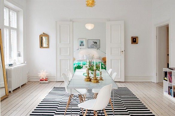 5 Times IKEA Looked Deceptively Elegant via @mydomaine-- IKEA Stockholm  Rug - I like the contrast in all white space, with the graphic black and white rug!!