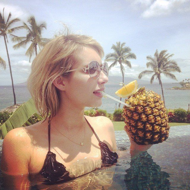 Emma Roberts enjoying a pineapple drink in the pool with palm trees - ahh:D