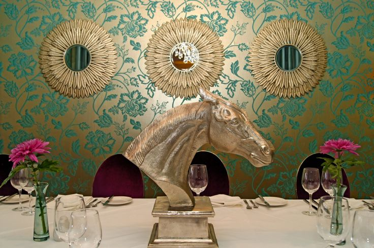The Wildflower Restaurant alcove, mirrors and horse head in semi private dining area