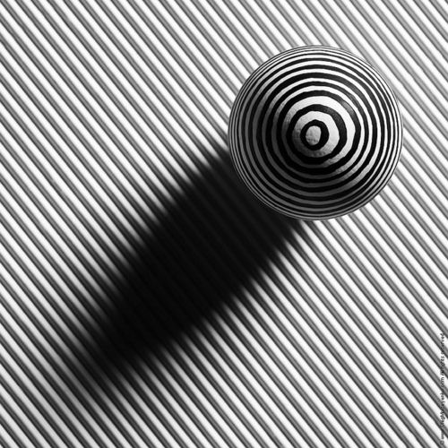 Lines and sphere in black and white.
