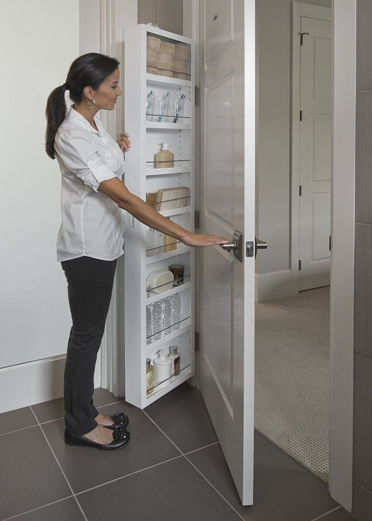 Attach A Storage Cabinet Behind The Door To Permanently