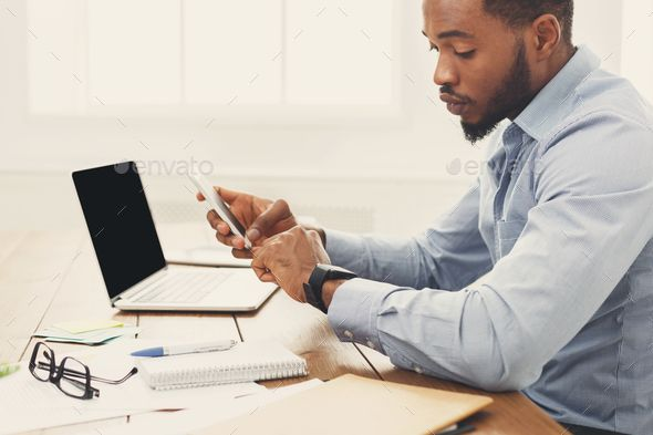 Young Black Businessman With Smartwatch In Office Young Black Business Man Young Black Professional
