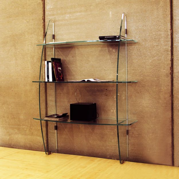 #EMISFERA.   Wall bookcase with rounded line in extra-clear tempered and laminated cut glass, formed by unions and joints of vertical and horizontal elements