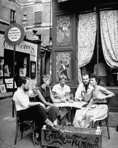 CafeSociety - A group sipping drinks at a sidewalk cafe, Paris, 1949