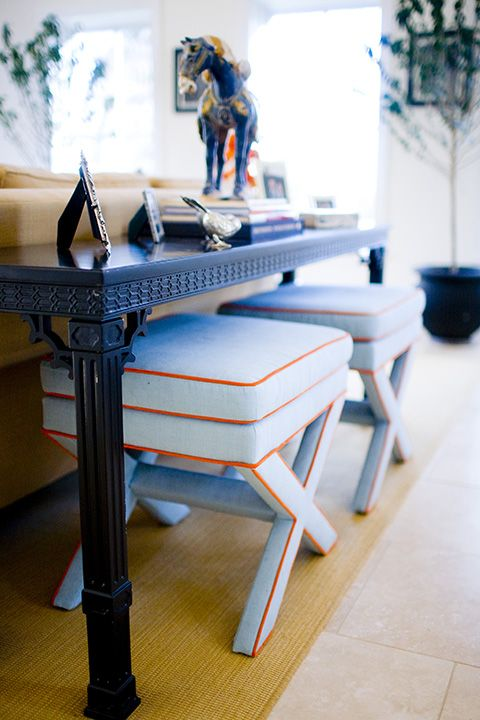 Mona Ross Berman Interiors » upholstered stools tucked under console; blue and orange