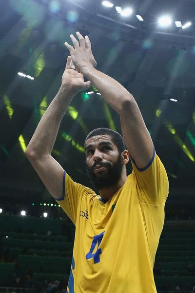 Wallace de Souza of Brazil celebrates victory over Russia during the Men's Volleyball Semifinal match on Day 14 of the Rio 2016 Olympic Games at the Maracanazinho on August 19, 2016 in Rio de Janeiro, Brazil.