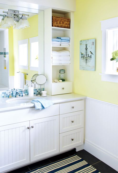 I like the soft yellow and white- will make it look larger, and can easily change the decor to change entire look of bathroom without having to redo the bathroom walls/cabinets.