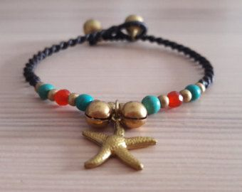 Welcome to Bohemian Style Thai Jewellery. You are looking at a gorgeous star charm bracelet, featuring bright red agate and turquoise howlite stones. The bracelet fastens at 2 lengths with a loop and ball fastening. The remainder of the bracelet is skillfully woven black waxed cotton macrame, which is strong, durable and long-lasting.   www.bohemianstyleshop.etsy.com