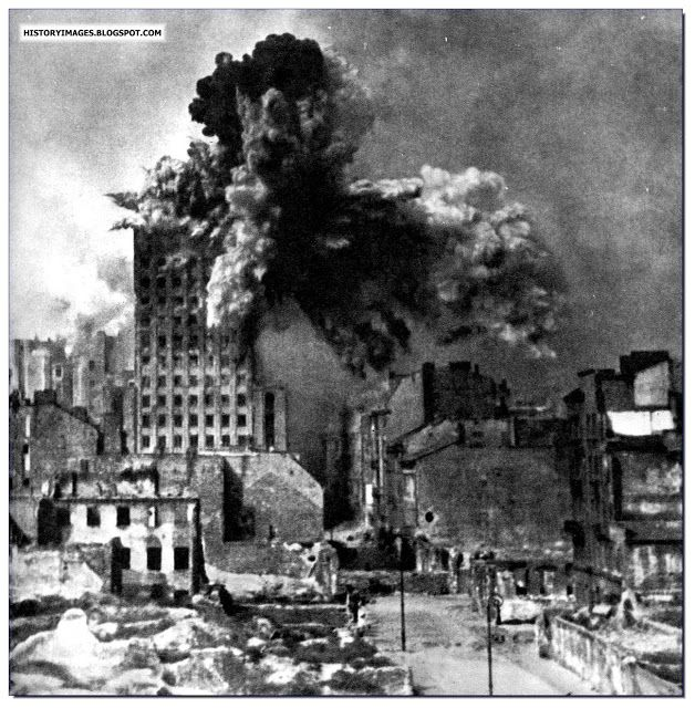 Polish Tragedy: Warsaw Uprising Of 1944. The Germans used massive 600 mm guns to flatten insurgent positions. Here the Prudential building is hit. It collapsed in seconds.