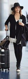 Jessica Alba showed she still has her feet on the ground despite being named America's richest self-made woman when she arrived at JFK airport in New York on Monday.