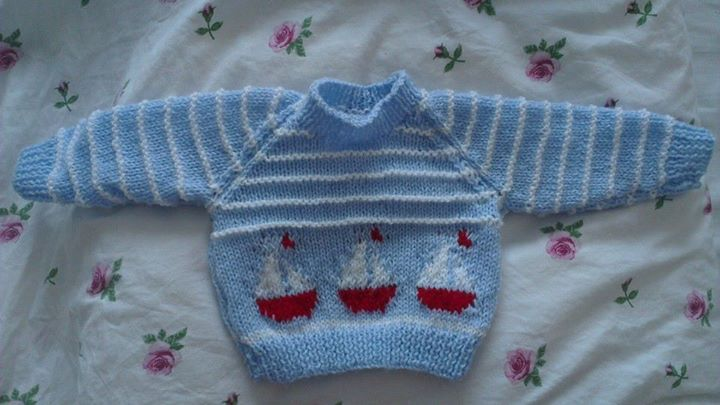 Newborn knitted jumper, in blue and white stripe with intarsia boats.